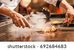 hand of man take cooking of... | Shutterstock . vector #692684683