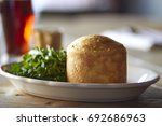 Small photo of Steak and ale pie with simple salad and a beer