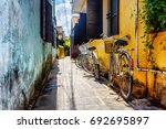 bicycles parked near yellow... | Shutterstock . vector #692695897