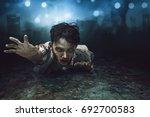 creepy asian zombie man lying...   Shutterstock . vector #692700583