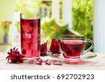 cup of hot hibiscus tea ... | Shutterstock . vector #692702923