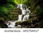 nice majestic waterfall in... | Shutterstock . vector #692704417