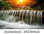 nice landscape with sunshine... | Shutterstock . vector #692704423