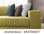 set of pillows on modern sofa... | Shutterstock . vector #692706037