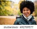 teenage girl winking and...   Shutterstock . vector #692709577
