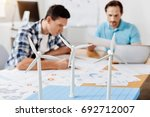busy young men studying data on ...   Shutterstock . vector #692712007