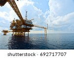 offshore oil rig in the middle... | Shutterstock . vector #692717707