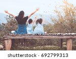 back view of happy family... | Shutterstock . vector #692799313