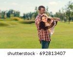 smiling african american... | Shutterstock . vector #692813407