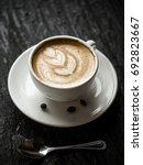 coffee latte art in dark light   Shutterstock . vector #692823667