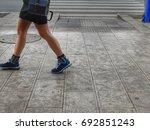 human legs part while walking... | Shutterstock . vector #692851243