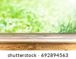 wooden table background | Shutterstock . vector #692894563