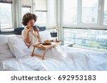 beauty woman sitting on bed ... | Shutterstock . vector #692953183