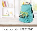 backpack with school supplies... | Shutterstock . vector #692969983