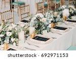 the wedding decor. the white... | Shutterstock . vector #692971153