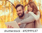 couple in love sitting on... | Shutterstock . vector #692999137