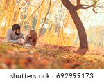 young couple in love lying on a ...   Shutterstock . vector #692999173