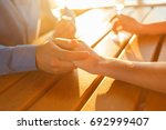 glasses of wine in the hands of ... | Shutterstock . vector #692999407