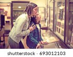 attractive mother and daughter... | Shutterstock . vector #693012103