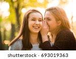 teenage girl whispering secret... | Shutterstock . vector #693019363