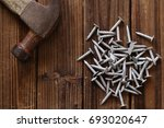 nails and hammer on wood. top... | Shutterstock . vector #693020647