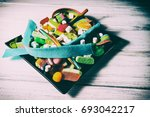 candy on a white wooden table | Shutterstock . vector #693042217