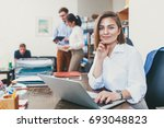 young woman on her laptop at... | Shutterstock . vector #693048823