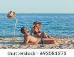 young couple in love lying on...   Shutterstock . vector #693081373