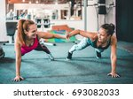 two female friends exercising... | Shutterstock . vector #693082033