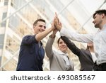 businessman with colleagues hi... | Shutterstock . vector #693085567