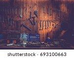 workshop scene. old tools... | Shutterstock . vector #693100663