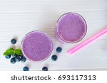 blueberry smoothies and... | Shutterstock . vector #693117313