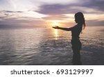 little asian girl put hands...   Shutterstock . vector #693129997