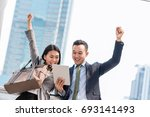 young happy asian businessman... | Shutterstock . vector #693141493