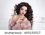 woman in fur coat. curly hair....   Shutterstock . vector #693153517