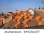 roofing  construction worker on ... | Shutterstock . vector #693156157