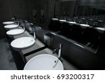 sink row from mirror reflection.   Shutterstock . vector #693200317