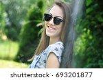 portrait of young brunette... | Shutterstock . vector #693201877