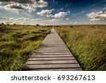 wide landscape with path | Shutterstock . vector #693267613