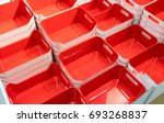 stack of red plastic trays... | Shutterstock . vector #693268837