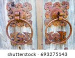 rusted locks on old wood gate... | Shutterstock . vector #693275143