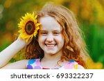cute little girl with...   Shutterstock . vector #693322237