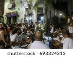 Small photo of Rio de Janeiro, Brazil, December 30, 2016: Samba is part of Carioca culture and one of the most traditional city of samba circles happens in Pedra do Sal, where in the past, there was a slave market