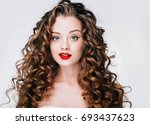 woman with red lipstick. curly... | Shutterstock . vector #693437623