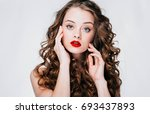 woman with red lipstick. curly... | Shutterstock . vector #693437893