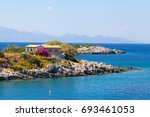 a small house on a cost besides ... | Shutterstock . vector #693461053