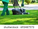 a garden worker takes on a lawn ... | Shutterstock . vector #693487573