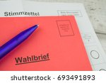 Small photo of Absentee ballot, documents for elections in Germany, red letter with the German inscription electoral letter