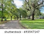 walkway in the beautiful green... | Shutterstock . vector #693547147