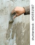 Small photo of Plasterer plaster wall plaster